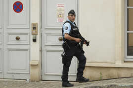 A French policeman stands outside team England's hotel for the UEFA 2016 European Championship, in Chantilly, France, June 8, 2016.