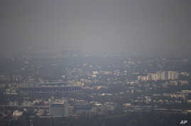 Mexico City's Azteca Stadium, left, is seen through a thick haze, Tuesday, March 15, 2016.