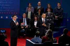 President Obama, right, and former Massachusetts Gov. Romney, participate in the second presidential debate at Hofstra University in Hempstead, N.Y., October 16, 2012.