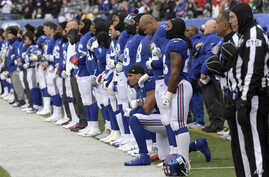 FILE - New York Giants defensive end Olivier Vernon kneels as the Giants stand for the national anthem before an NFL football game against the Washington Redskins Dec. 31, 2017, in East Rutherford, N.J.