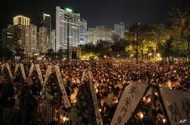 Hong Kong Tiananmen Anniversary: Tens of thousands of people attend a candlelight vigil at Victoria Park in Hong Kong, Saturday, June 4, 2016, to commemorate victims of the 1989 military crackdown in Beijing.