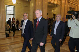 FILE - Former deputy Northern Ireland First Minister Martin McGuinness, center, at Stormont, Belfast, Northern Ireland, Jan. 16, 2017. McGuinness died Tuesday at age 66.