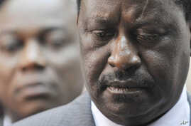 African Union envoy and Kenyan Prime Minister Raila Odinga gives a press conference at the Felix Houphouet Boigny airport in Abidjan before leaving Ivory Coast,  19 Jan 2011