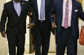 Bill Cosby, center, with supporter Joe Torry, left, and publicist Andrew Wyatt, right, arrives for his sexual assault trial at the Montgomery County Courthouse in Norristown, Pa., June 8, 2017.