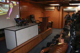 A video clip is shown about American-born news anchor on Iranian state television's English-language service, Marzieh Hashemi, during a press briefing by Paiman Jebeli, deputy chief of Iran's state IRIB broadcaster, in Tehran, Iran, Wednesday, Jan. 1