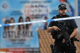 Armed police officers patrol a police cordon near the Manchester Arena in Manchester, May 24, 2017.