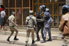 FILE - Ugandan security forces briefly beat then detain a protester in downtown Kampala, Uganda, Aug. 20, 2018.