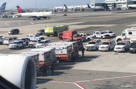The emergency services are seen, after the passengers were taken ill on a flight from New York to Dubai, on JFK Airport, New York, Sept. 05, 2018 in this still image obtained from social media. (Larry Coben/via Reuters)