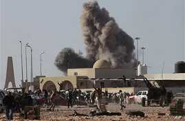 Anti-Gadhafi rebels run away as smoke rises following an air strike by Libyan warplanes near a checkpoint of the anti-Libyan Leader Moammar Gadhafi rebels, in the oil town of Ras Lanouf, eastern Libya, March 7, 2011