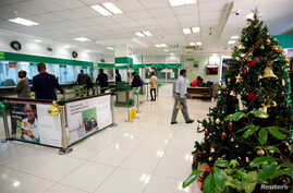 FILE - A Christmas tree is placed inside a banking hall of Consolidated Bank along Koinange Street in Nairobi, Dec. 10, 2018.