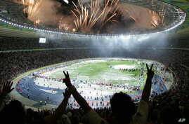 FILE - In this July 9, 2006, photo, Italian soccer fans celebrate after Italy beat France 5-3 in a penalty kick shootout to win the final of the soccer World Cup between Italy and France in the Olympic Stadium in Berlin, Germany.