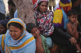 FILE - Rohingya women and children are seen at a temporary shelter in the Kalindi Kunj area of New Delhi, India, April 15, 2018.