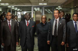South African President Jacob Zuma (L), Zimbabwean President Robert Mugabe (2nd L), Lesotho Prime Minister Tom Thabane (C) and Botswana President Ian Khama (2nd R) stand for a group photo following an emergency meeting on the current situation in Les...