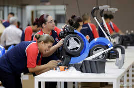 Workers assemble riding toys for Brazilian toymaker Estrela at a factory in Hernandarias, Paraguay Feb. 7, 2017.