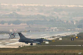 Turkish fighter jets taxi on the runway of the Incirlik airbase, southern Turkey, Aug. 31, 2013.