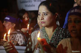 Women hold lighted candles during a rally condemning the attack on schoolgirl Malala Yousufzai, in Karachi, Pakistan, October 11, 2012.