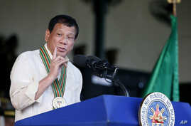 Philippine President Rodrigo Duterte gestures while addressing army troops during the 120th anniversary celebration of the Philippine Army, April 4, 2017 at Fort Bonifacio.