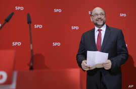Social Democratic Party, SPD, chairman and top candidate in the upcoming general elections Martin Schulz arrives for a statement after first projections of the state election in German state Saarland announced at the party's headquarters in Berlin, S
