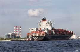 Commerce department report indicates U.S. businesses boosted inventory to spur better-than-expected growth. Above, a container ship on its way to unload its cargo at Port Everglades in Fort Lauderdale, Florida, Sept. 27, 2012.