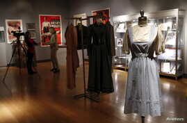 "The ""Dorothy"" dress warn by Judy Garland in The Wizard of Oz is seen during a media preview of Bonhams and Turner Classic Movies Treasures from the Dream Factory at Bonhams in New York, Nov. 19, 2015."