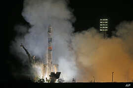 The Soyuz-FG rocket booster with Soyuz TMA-12M space ship carrying a new crew to the International Space Station (ISS) blasts off at the Russian leased Baikonur cosmodrome, Kazakhstan, March 26, 2014.