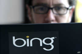 Microsoft vendor Patrick Porter works on a laptop marked with the logo for Bing in a cafeteria at the company, July 29, 2009, in Redmond, Wash.