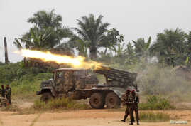 FILE - Congolese soldiers from the Armed Forces of the Democratic Republic of Congo [FARDC] launch missiles during their military operation against Ugandan Islamist group, the Allied Democratic Forces, outside the town of Beni, in North Kivu province