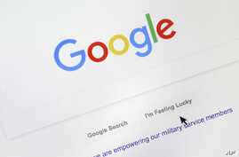 A cursor moves over Google's search engine page on Aug. 28, 2018, in Portland, Ore.