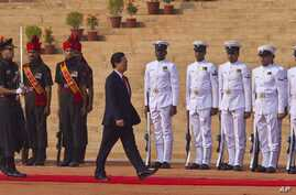 Vietnam Prime Minister Nguyen Tan Dung, inspects a guard of honor at the forecourt of the Indian President's palace in New Delhi, India, Tuesday, Oct. 28, 2014.