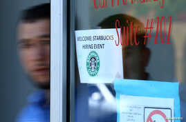 FILE - Refugees leave a job interview with Starbucks as the company takes part in a corporate commitment to globally hire 10,000 refugees with a meeting in El Cajon, California, U.S.