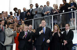 New Secretary of State Mike Pompeo (C), with wife Susan Pompeo, and son Nick Pompeo (R) is applauded after speaking to State Department employees as he arrives at the State Department in Washington, May 1, 2018.