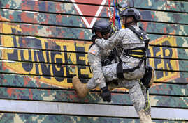 Members of the U.S. Army National Guard demonstrate rappelling skills during the Urban Search and Rescue activity of the 2016 RP-U.S. Balikatan joint military exercises in Camp Capinpin in Tanay, Rizal, east of Manila, Philippines, April 8, 2016.