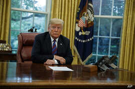 President Donald Trump listens during a phone call with Mexican President Enrique Pena Nieto about a trade agreement between the United States and Mexico, in the Oval Office of the White House, Aug. 27, 2018, in Washington.