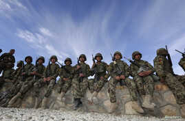 Afghan soldiers wait before the handover ceremony between French army and ANA (Afghan National Army) at the forward operational base of Nijrab as part of the withdrawal of the French troops November 20, 2012.