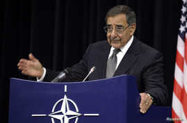 United States Secretary of Defense Leon Panetta gestures while speaking during a media conference after a meeting of NATO Defense Ministers at NATO headquarters in Brussels on Wednesday, October 10, 2012.