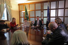 NATO Secretary General Jens Stoltenberg, center, speaks during a media roundtable discussion at Resolute Support headquarters in Kabul, Afghanistan, Wednesday, March 16, 2016.