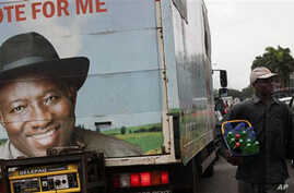 A truck with an election campaign banner depicting Nigeria's incumbent President Goodluck Jonathan, in Lagos, Nigeria, Wednesday, April 13, 2011.