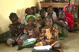 Children are seen sitting on the floor of their school in Fotokol, Cameroon. (M.E. Kinzeka/VOA)