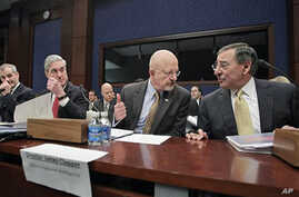 Director of National Intelligence James Clapper (second from right) and heads of other national security agencies gather on Capitol Hill to testify before the House Intelligence Committee, February 10, 2011