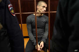 FILE - In this  Nov. 10, 2015, file photo, Russian performance artist Pyotr Pavlensky sits in a court room before a hearing on his case in Moscow, Russia.