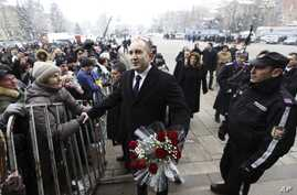Newly elected Bulgarian President Rumen Radev, greets his supporters after his inauguration ceremony in Sofia, Bulgaria, Jan. 22, 2017.