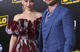 """Emilia Clarke and Alden Ehrenreich arrive at the premiere of """"Solo: A Star Wars Story"""" at El Capitan Theatre, May 10, 2018, in Los Angeles."""