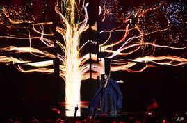 """Ukraine's Jamala performs the song """"1944"""" during the Eurovision song contest final in Stockholm, Sweden, May 14, 2016."""