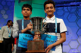 FILE - Co-champions Nihar Janga, left, and Jairam Hathwar hold their trophy upon completion of the final round of Scripps National Spelling Bee at National Harbor, Md., May 26, 2016.