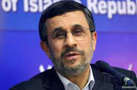 FILE -  Mahmoud Ahmadinejad talks during a news conference at the end of his visit to Cairo,  Egypt, Feb. Feb. 7, 2013.