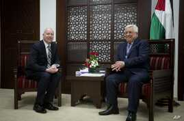 U.S. President Trump's peace process envoy Jason Greenblatt, left, meets with Palestinian President Mahmoud Abbas at the President's office in the West Bank city of Ramallah, March 14, 2017.