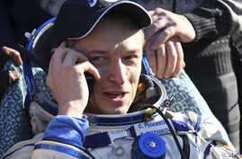 Russian cosmonaut Sergey Ryzhikov uses a sat phone shortly after landing near Dzhezkazgan, Kazakhstan Monday, April 10, 2017, on the treeless Central Asian steppes Russia's Soyuz MS-02 space capsule carrying the International Space Station (ISS) crew