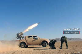 This May 25, 2017 photo provided by the government-controlled Syrian Central Military Media, shows Syrian government troops firing multiple launcher rockets at insurgent group's position in the Syrian province of Homs.