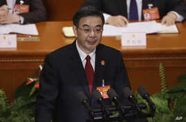 China's Chief Justice Zhou Qiang delivers a speech during a plenary session of the National People's Congress at the Great Hall of the People in Beijing, March 12, 2017. Zhou said Sunday that his country, which is believed to execute more people than