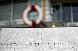 FILE - The balcony where the Rev. Martin Luther King Jr. was killed on April 4, 1968, stands above a plaque on  Martin Luther King Jr. Day, in Memphis, Tenn.,Jan. 16, 2017. Residents of Memphis are honoring King's legacy with neighborhood clean-up ev